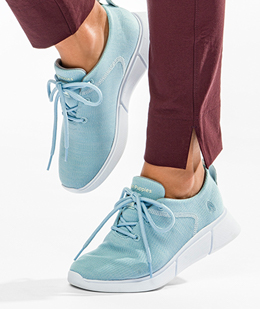 woman wearing light blue Hush Puppies shoes